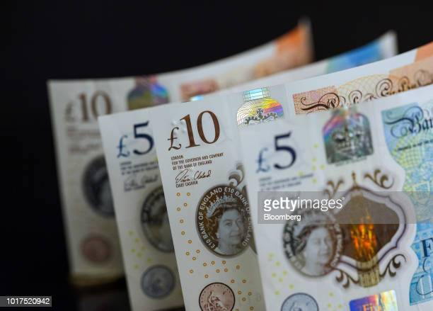 British 10 and five pound banknotes stand in this arranged photograph in London UK on Wednesday Aug 15 2018 The pound's weakness is turning...