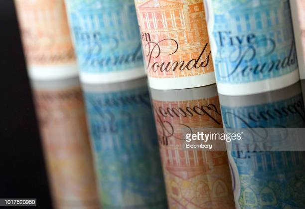 British 10and five pound banknotes stand in this arranged photograph in London UK on Wednesday Aug 15 2018 The pound's weakness is turning...