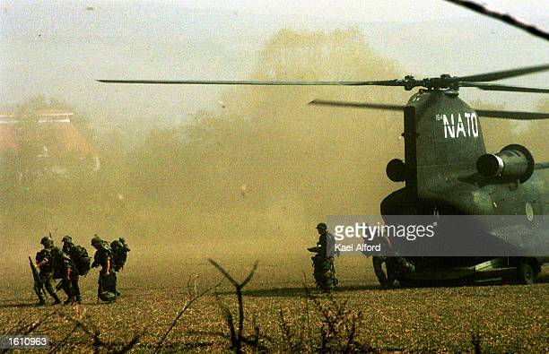 British 16th Air Assault paratroopers arrive by Chinook transport helicopter August 27 2001 in Otlja Macedonia to take part in the NATO effort to...