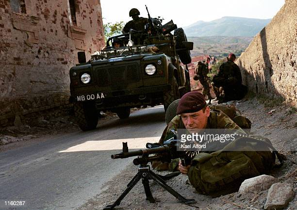 British 16th Air Assault paratroopers secure the village of Matejce August 27 2001 in the Kumanovo region of Macedonia as they help set up the first...