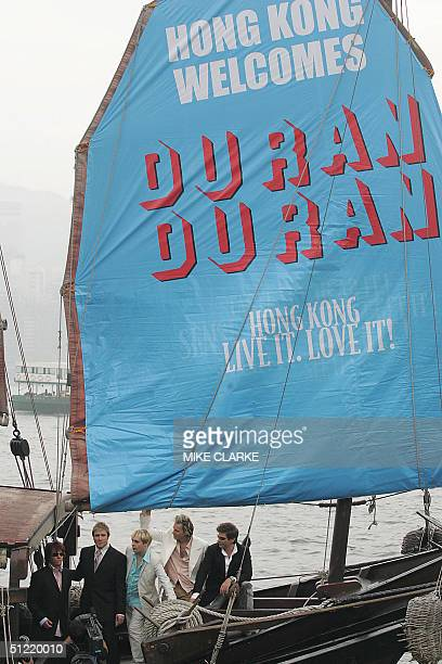 British 80's pop band Duran Duran have their pictures taken during a promotional album tour on a boat in Hong Kong 26 August 2004 LR GuitarAndy...