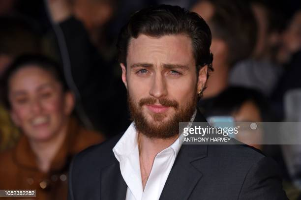 British actor Aaron TaylorJohnson poses upon arrival for the European premiere of the film 'Outlaw King' during the BFI London Film Festival in...