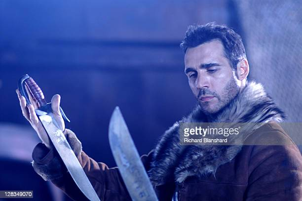 British actor Adrian Paul as Immortal warrior Duncan MacLeod in the film 'Highlander The Source' 2007 Here he handles a pair of butterfly swords