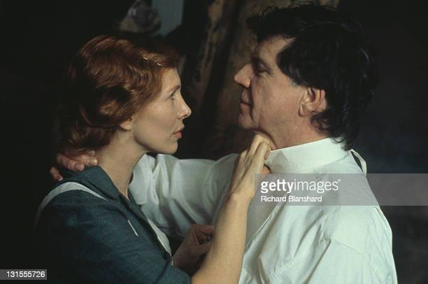 British actor Alan Bates as Sir Hugo Coal and Trudie Styler as the maid Doris in a scene from the film 'The Grotesque' 1995