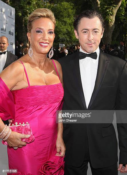 British actor Alan Cumming and songwriter Denise Rich arrive at amfAR's Cinema Against AIDS 2008 benefit held at Le Moulin de Mougins during the 61st...