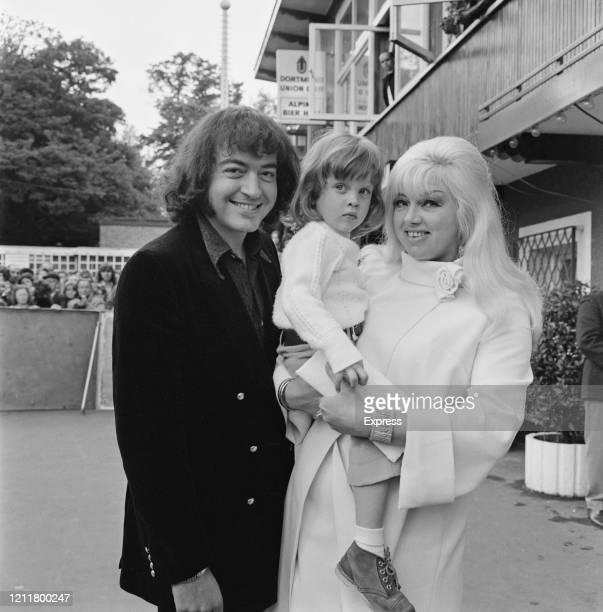 British actor Alan Lake with British actress Diana Dors and their son actor Jason Dors Lake at Battersea Fun Fair in London England 10th June 1972