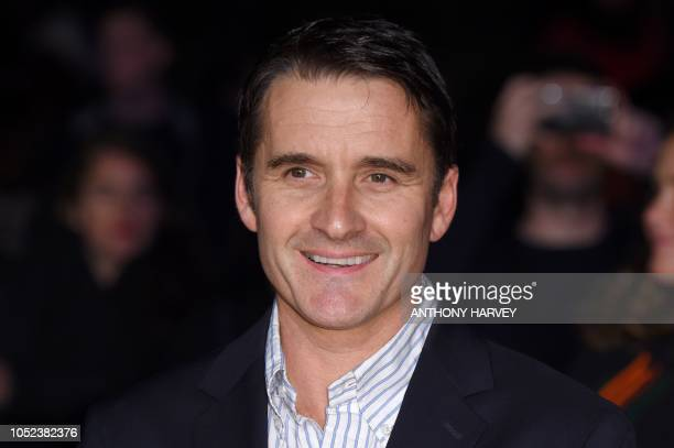 British actor Alastair Mackenzie poses upon arrival for the European premiere of the film 'Outlaw King' during the BFI London Film Festival in London...
