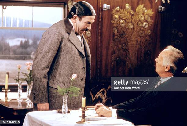 British actor Albert Finney and American Richard Widmark on the set of Murder on the Orient Express based on the novel by British Agatha Christie and...