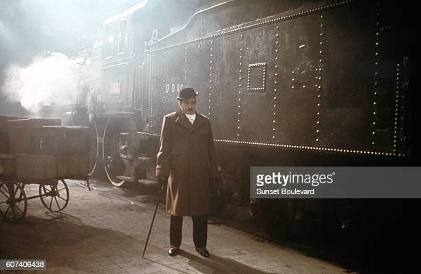 British actor Albert Finney on the set of Murder on the Orient Express, based on the novel by British Agatha Christie, and directed by American...