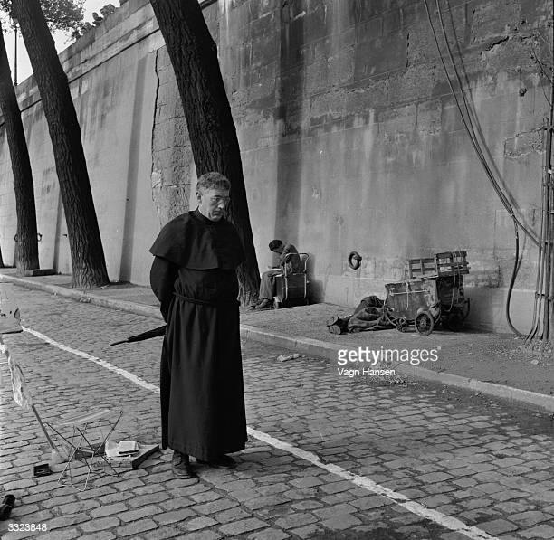 British actor Alec Guinness on location in Paris during filming of 'Father Brown' in which he plays G K Chesterton's famous priest detective Titled...