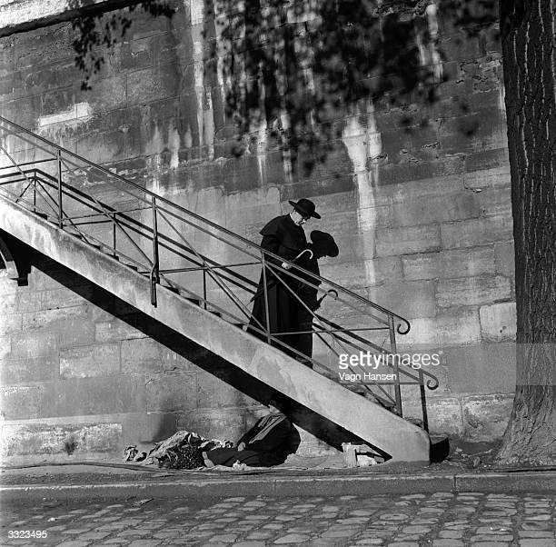 British actor Alec Guinness on location in Paris for the filming of 'Father Brown' in which he plays G K Chesterton's famous priest detective Titled...
