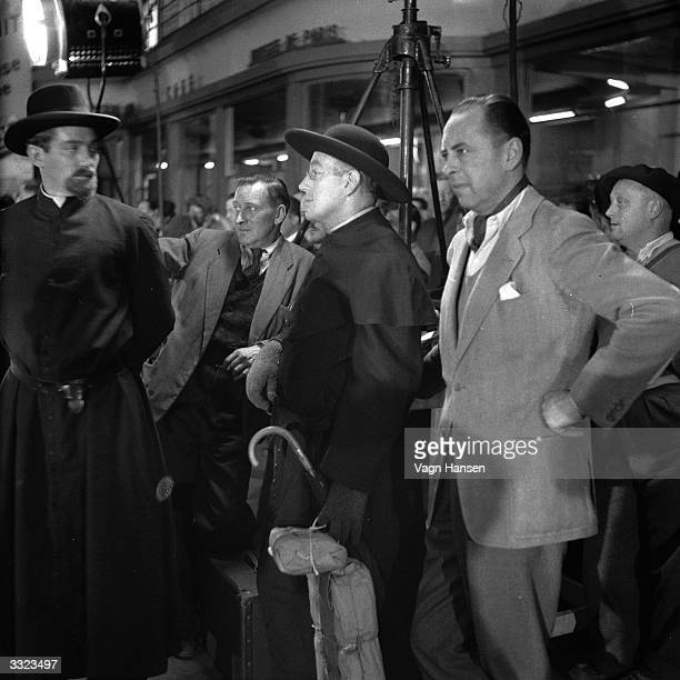 British actor Alec Guinness on location in Paris for the filming of 'Father Brown' in which he plays the famous priest detective created by G K...