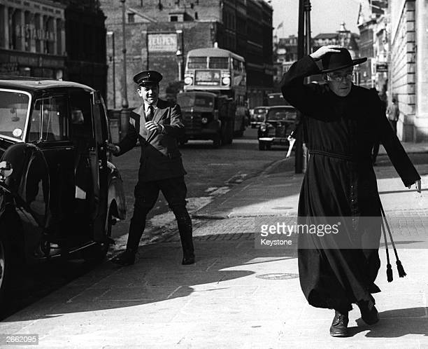 British actor Alec Guinness plays G K Chesterton's famous crimesolving priest in the eccentric comedy 'Father Brown' A cab driver played by Sid James...