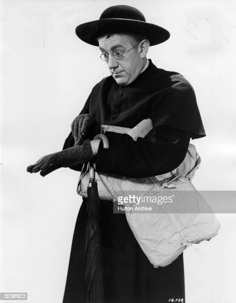 British actor Alec Guinness plays the crimebusting priest in the eccentric comedy based on G K Chesterton's 'Father Brown' series Titled 'The...