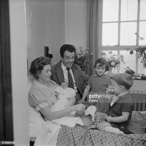 British actor and activist Brian Rix and wife actress Elspet Gray introduce their newborn Jonathan to his siblings Louisa and Jamie UK 1960