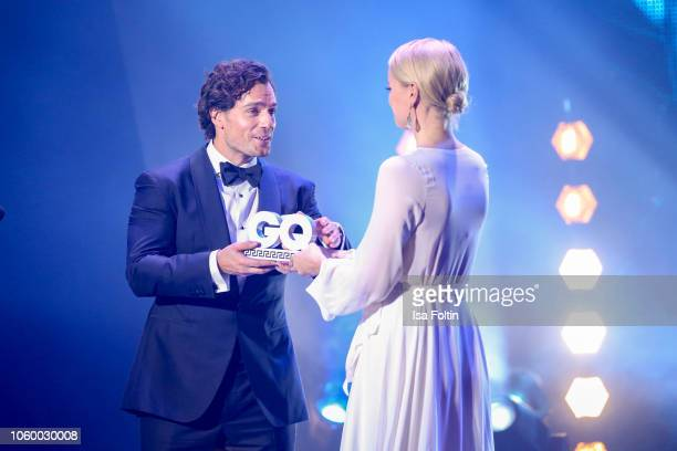British actor and award winner Henry Cavill and German model Franziska Knuppe are seen on stage during the GQ Men of the Year Award show at Komische...