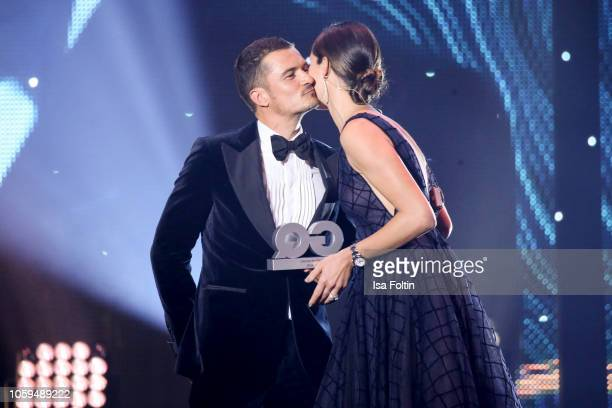 British actor and award winner Orlando Bloom and Ana IvanovicSchweinsteiger are seen on stage during the GQ Men of the Year Award show at Komische...
