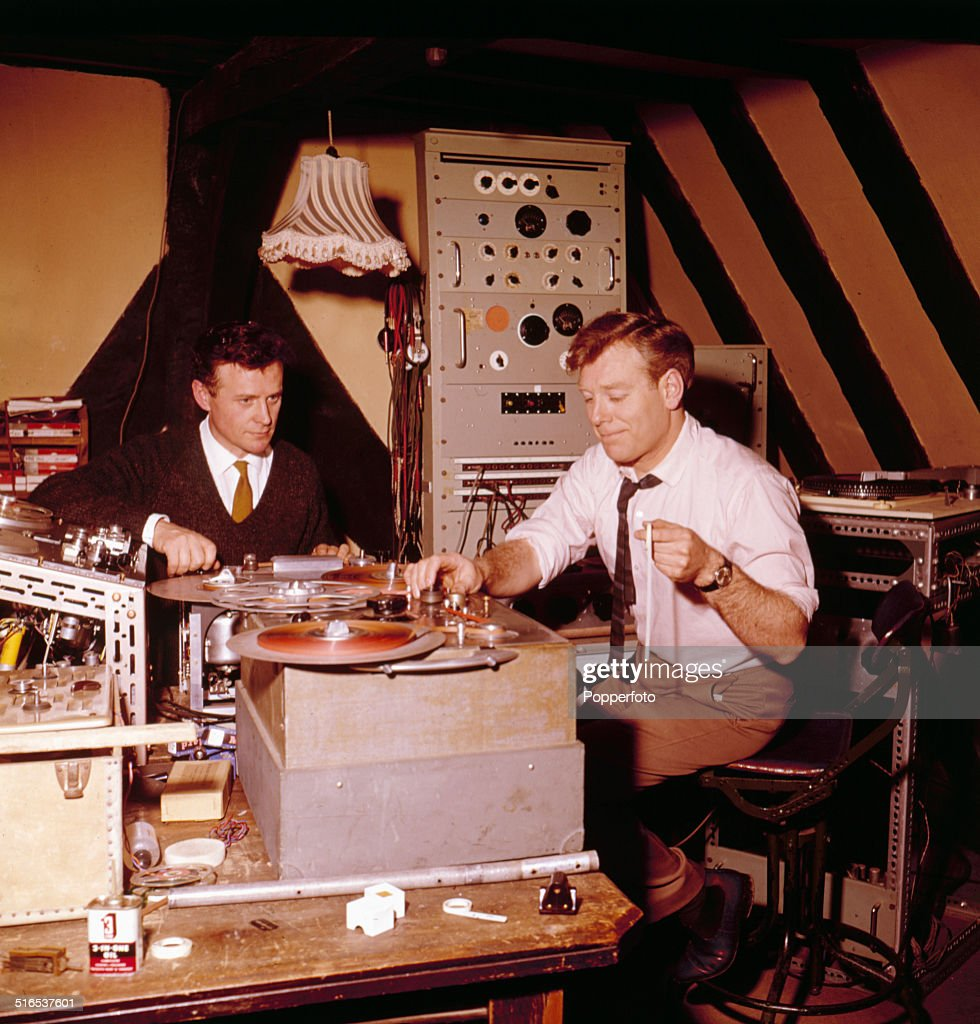 British actor and broadcaster Desmond Carrington pictured with Spencer Hale editing a recording a radio programme in 1964.