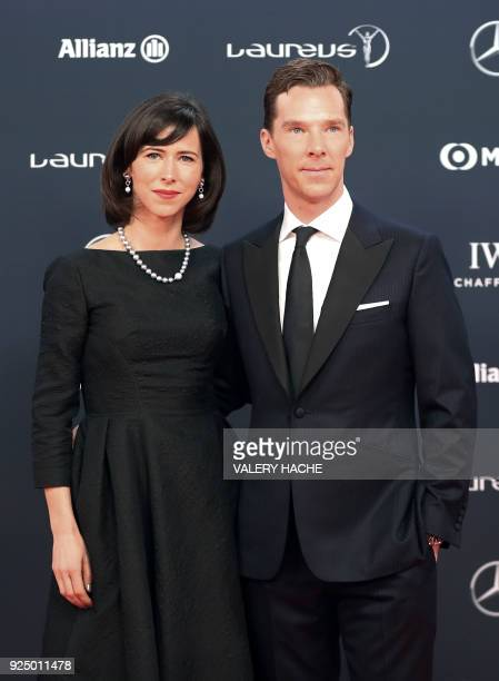 British actor and ceremony host Benedict Cumberbatch and his wife Sophie Hunter pose on the red carpet before the 2018 Laureus World Sports Awards...