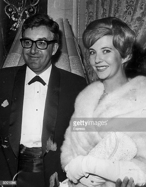 British actor and comedian Peter Sellers and his first wife Anne Howe attend a formal event London England Sellers is dressed in a tuxedo Hayes wears...