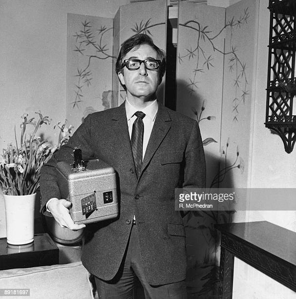 British actor and comedian Peter Sellers carrying a miniature fruit machine an unusual Christmas present 30th December 1965