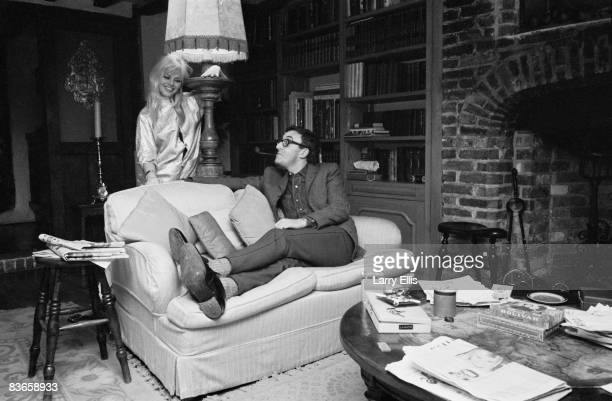 British actor and comedian Peter Sellers with actress Britt Ekland at Brookfield, his home in Elstead, Surrey, February 1964.