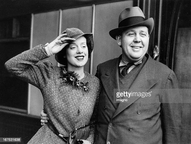 British actor and director Charles Laughton and his wife Elsa Lanchester Waterloo station/London March 3th 1934 Photograph Der britische Schauspieler...