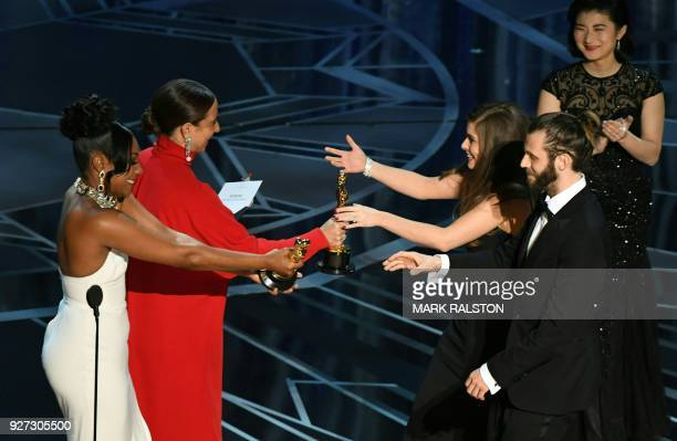 British actor and director Chris Overton and British actress Rachel Shenton are congratulated by US actress Maya Rudolph and comedian Tiffany Haddish...