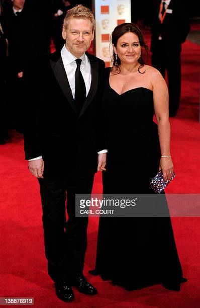 British actor and director Kenneth Branagh and his wife director Lindsay Brunnock pose on the red carpet arriving at the BAFTA British Academy Film...