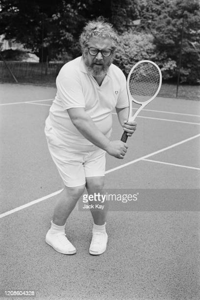 British actor and dramatist Peter Ustinov sporting a beard as he plays British tennis player Bobby Wilson for BBC television series 'Star Sports' in...