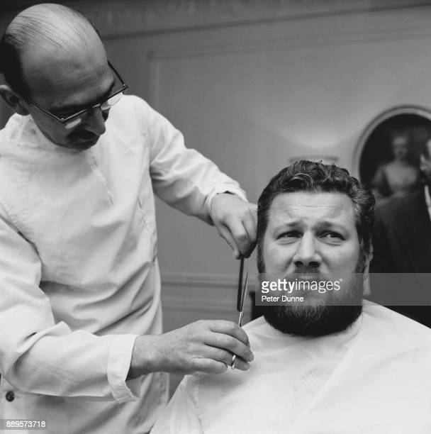 British actor and filmmaker Peter Ustinov getting a beard cut by a barber, UK, 24th May 1961.