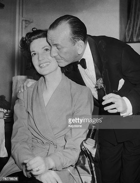 British actor and playwright Noel Coward congratulates English actress Judy Campbell on her performance as Miranda Frayle in his play 'Relative...