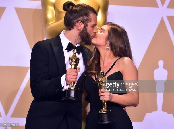 British actor and producer Chris Overton and British actress Rachel Shenton poses in the press room with the Oscar for Best Live Action Short Film...