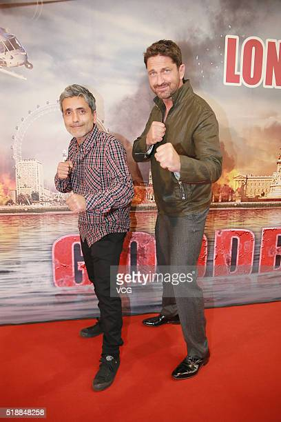 British actor and producer Gerard Butler and director Babak Najafi attend a celebration party of new movie 'London Has Fallen' on April 2 2016 in...