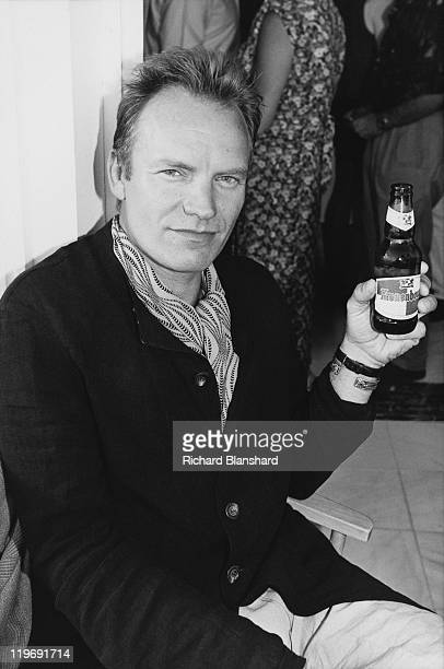 British actor and singer Sting promotes his film 'The Grotesque' at the Cannes Film Festival May 1995 Ge is drinking a bottle of Kronenbourg