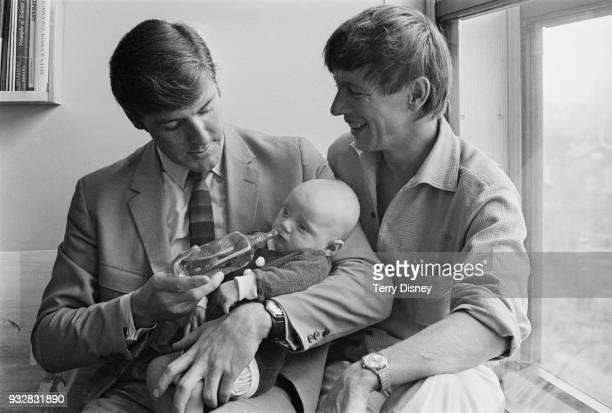 British actor and television presenter Peter Purves holding 14weekold Daniel Scott with British television presenter John Noakes UK 27th September...