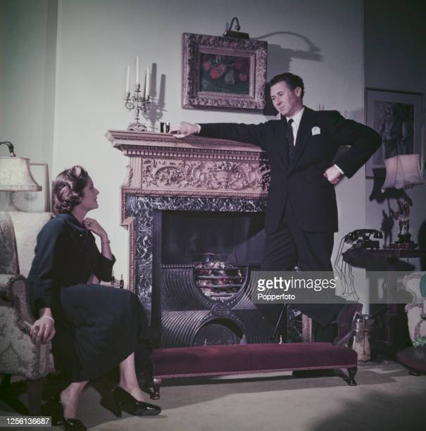 British actor and theatre director Anthony Quayle talks wih his wife American actress Dorothy Hyson in a living room at home in London in May 1956