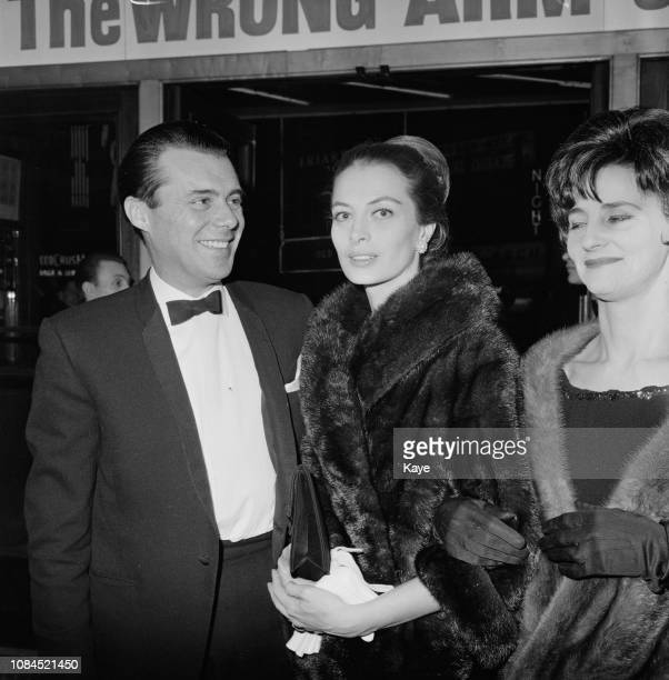British actor and writer Dirk Bogarde with French fashion model and actress Capucine at the premiere of 'The Mind Benders' at the Warner Theatre...