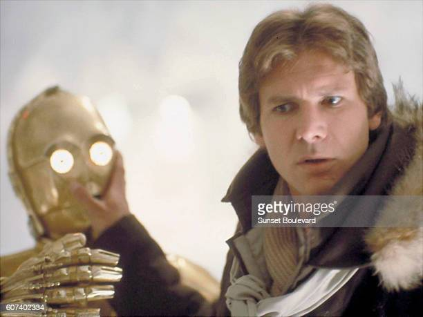 British actor Anthony Daniels and American Harrison Ford on the set of Star Wars: Episode V - The Empire Strikes Back directed by Irvin Kershner.
