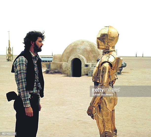 British actor Anthony Daniels with American director screenwriter and producer George Lucas on the set of his movie Star Wars Episode IV A New Hope