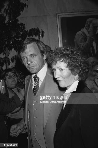 British actor Anthony Hopkins, wearing a grey three-piece suit with a white shirt and polka dot tie, and his wife, Jennifer Lynton, attending an...