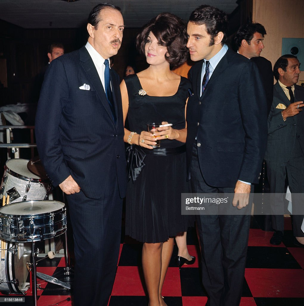 British actor Anthony Newley (Left), and his lovely wife, Joan Collins, visit with producer David Merrick at Danny's hide-a-way, September 24th. The occasion was a surprise birthday party given by miss Collins for her husband on his 34th birthday.