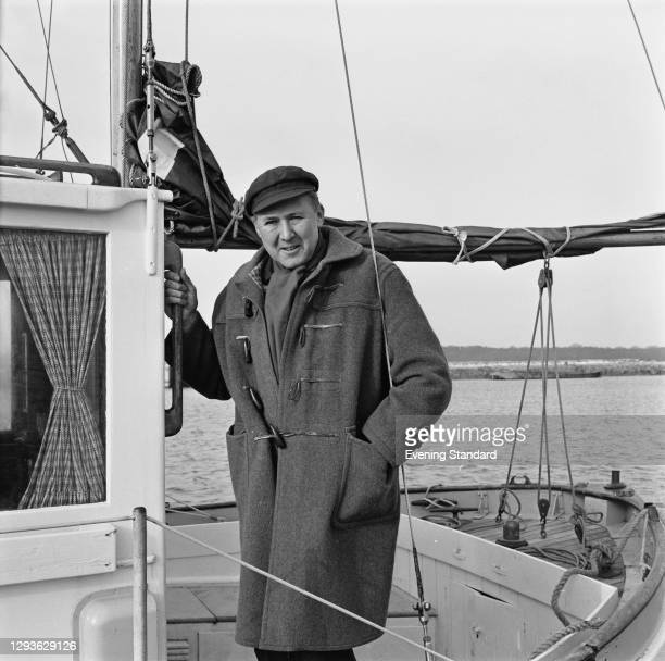British actor Anthony Quayle on a sailing boat, UK, 20th January 1966.