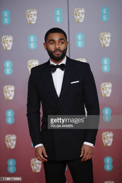 British actor Anthony Welsh poses on the red carpet upon arrival at the BAFTA British Academy Film Awards at the Royal Albert Hall in London on...