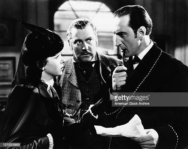 British actor Basil Rathbone as fictional detective Sherlock Holmes with Nigel Bruce as Doctor Watson in 'The Adventures of Sherlock Holmes' 1939...
