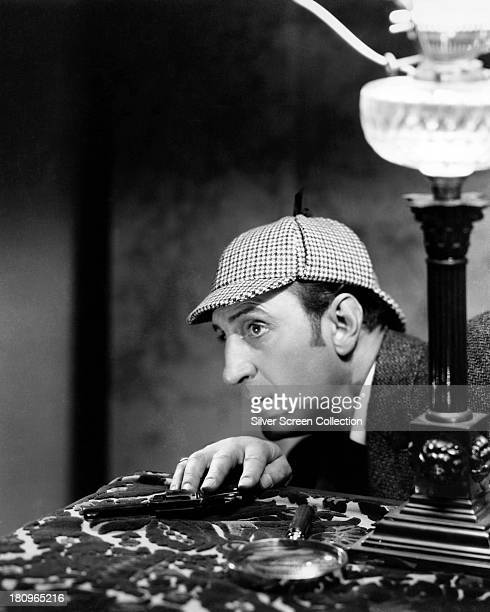 British actor Basil Rathbone as Sherlock Holmes in a promotional portrait for one of the fourteen films in which he played the role circa 1942