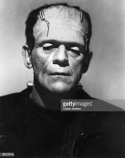 British actor Boris Karloff lowers his eyes as the Monster in a promotional portrait for director James Whale's film 'Frankenstein'