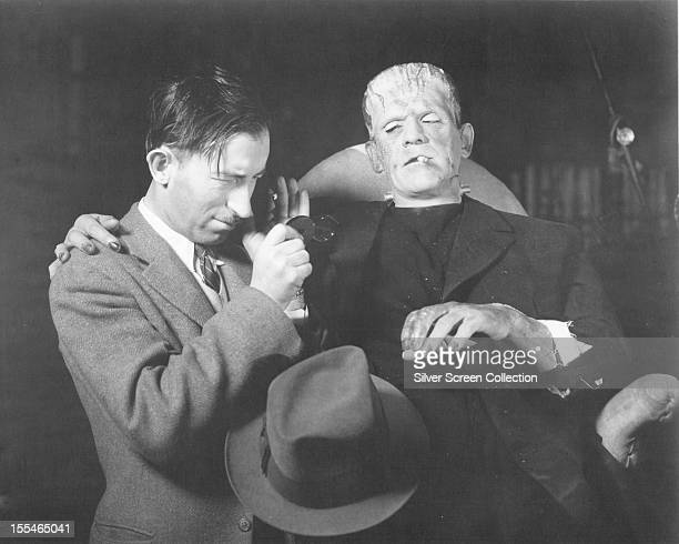 British actor Boris Karloff on the set of 'Frankenstein' with a member of the film crew, directed by James Whale, 1931.