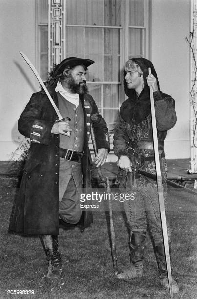British actor Brian Blessed in costume as Long John Silver promoting HTV drama 'Return to Treasure Island' alongside British actor Jason Connery who...