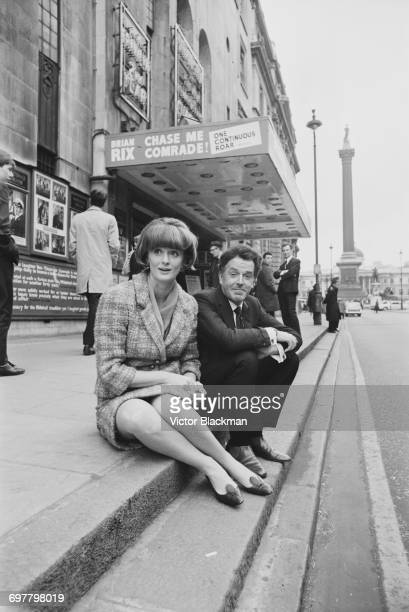 British actor Brian Rix and his wife Elspet Gray outside the Whitehall Theatre which is showing his Whitehall farce 'Chase Me Comrade' London UK 1st...